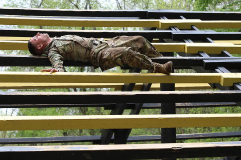Sgt. Stephen Calderone, a native of Cleveland, Ohio, a Satellite Communications System Operator-Maintainer (25S) from 58 Signal Company, 101st Special Troops Battalion, 101st Airborne Division, a competitor in the 101st's NCO, Soldier of the Year, executes the weaver at The Sabalauski Air Assault School's on Fort Campbell, April 24. (Sgt. Sharifa Newton, 40th Public Affairs Detachment)