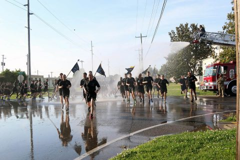 Soldiers from 101st Airborne Division, get sprayed by a hose as they run 4 miles in a division run for Week of the Eagles, May. 24 on Fort Campbell, Ky. Week of the Eagles was a tradition started in 1973 as an effort to reinvigorate the sense of community and is still carried on today to also honor those who served. (Sgt. Sharifa Newton, 40th Public Affairs Detachment)