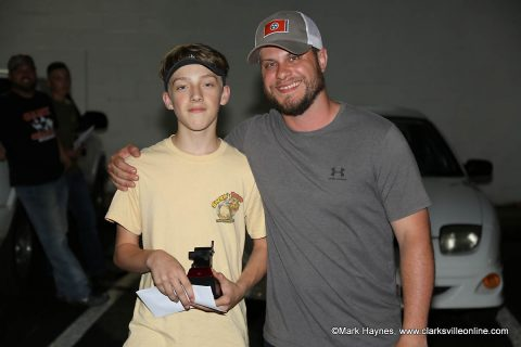 Dylan Byard (left) was the first place winner of Hilltop Supermarket's 1st annual Country Kids Cook-Off. Cody Jackson (right) gave Byard his trophy and cash prize.