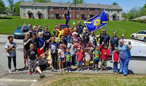 Clarksville Police Department Officers and Clergy Rapid Mobilization Team in Summit Heights preforming Community Outreach