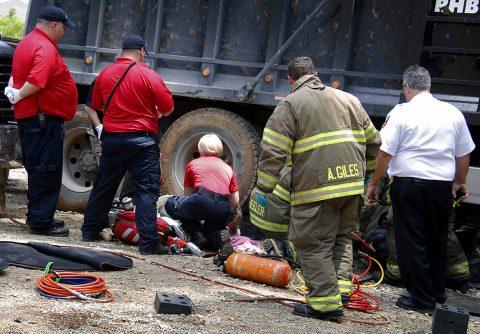 Clarksville emergency crews work to free Scott Flitsch's leg from underneath a dump truck. (Jim Knoll, Clarksville Police Department)