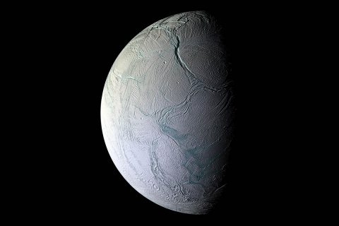 Saturn's moon Enceladus hides an ocean beneath its icy crust. Water interacting with rock on the sea floor could potentially yield chemical reactions that would make microbial metabolism possible. (NASA)