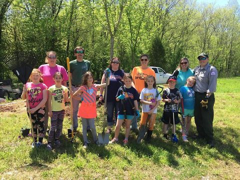Girl Scouts from Troop 390 pose after planting native plants and grasses April 28, 2018 that will become an Ecological Landscape Exhibit for visitors to Cheatham Lake in Ashland City, Tennessee.