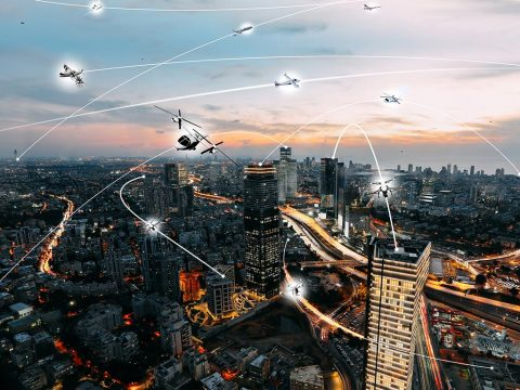 An artist's conception of an urban air mobility environment, where air vehicles with a variety of missions and with or without pilots, are able to interact safely and efficiently. (NASA / Lillian Gipson)
