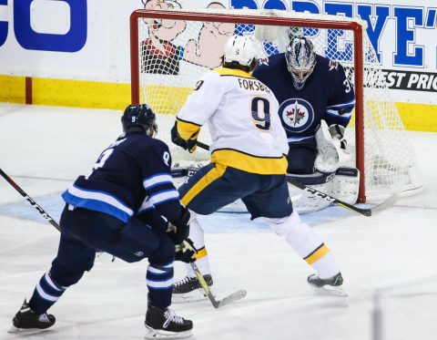 Nashville Predators left wing Filip Forsberg (9) scores a goal against Winnipeg Jets goaltender Connor Hellebuyck (37) in the third period in game six of the second round of the 2018 Stanley Cup Playoffs at Bell MTS Centre. (Terrence Lee-USA TODAY Sports)
