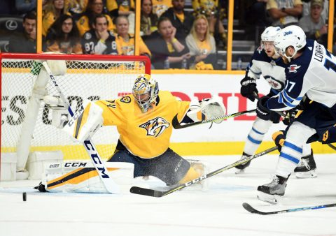 May 5, 2018; Nashville, TN, USA; Nashville Predators goalie Juuse Saros (74) makes a save on a shot by Winnipeg Jets center Adam Lowry (17) during the third period in game five of the second round of the 2018 Stanley Cup Playoffs at Bridgestone Arena. Mandatory Credit: Christopher Hanewinckel-USA TODAY Sports