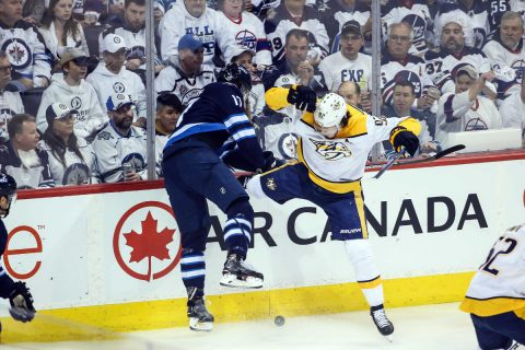 Winnipeg Jets forward Adam Lowry (17) bodies Nashville Predators forward Ryan Johansen (92) during the first period in game three of the second round of the 2018 Stanley Cup Playoffs at Bell MTS Place. (Terrence Lee-USA TODAY Sports)