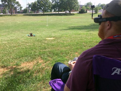 Austin Peay State University Drone Club president Mike Hunter fires up one of the racing drones.