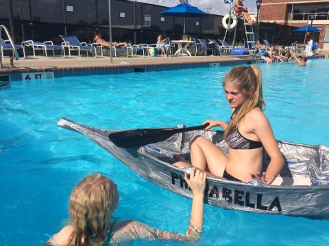 Merrol Hyde Magnet School senior Gracie Gumm discusses the boat with Signal Mountain Middle/High School senior Lili Swann.