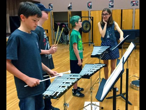 Mackenzie Kelly works with percussion students during Austin Peay's beginning band program for homeschool students.