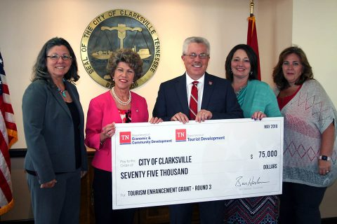 Kevin Triplett, Commissioner of Tourist Development, presented a $75,000 grant to City of Clarksville and Convention and Visitors Bureau officials on Monday. They are, from left, City Grants Administrator Debbie Smith, Clarksville Mayor Kim McMillan, Michelle Dickerson and Francis Mancito.