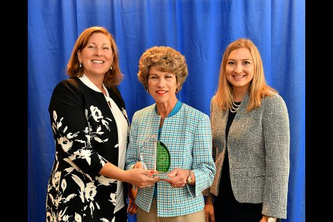 Susan Moulton, left, with Waste Management Inc., presented a City Livability Award to Clarksville Mayor Kim McMillan and Chief of Staff Heather Fleming during the U.S.Conference of Mayors annual conference Saturday.