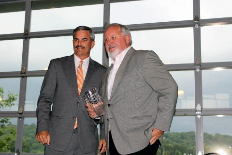 Chamber Chairman Charlie Koon (Left) gives F&M Bank's Sammy Stuard (Right) the Clarksville Area Chamber of Commerce Lifetime Achievement Award.