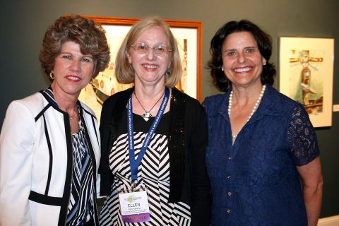 Clarksville Mayor Kim McMillan, AHDC Director Ellen Kanervo and Anne Pope, executive director of the Tennessee Arts Commission, gathered Wednesday to greet an arts conference reception audience at the Customs House Museum.
