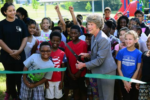 Clarksville Mayor Kim McMillan, joined by more than 50 children and staff from the Kleeman Community Center, cut a ribbon during the ribbon cutting ceremony at Bel-Aire Park June 7th, 2018. The ceremony marked the official reopening of the park, after it received much needed equipment upgrades. Improvements include a new playground that meets the current guidelines under the Americans with Disabilities Act.