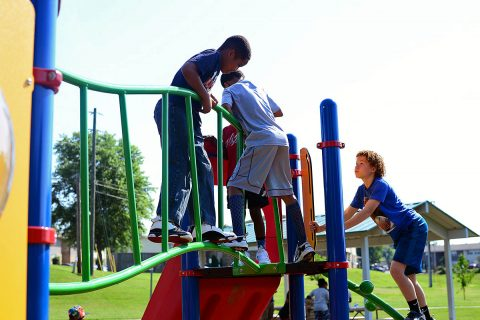 Children from the Kleeman Community Center enjoy the newly renovated Bel-Aire Park after the ribbon cutting ceremony June 7th, 2018.