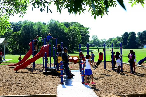 Children from the Kleeman Community Center enjoy the newly renovated Bel-Aire Park after the ribbon cutting ceremony June 7th, 2018. The ceremony marked the official reopening of the park, after it received much needed equipment upgrades.