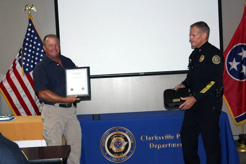 Clarksville Police Officer James Eure receives his Certificate of Retirement.