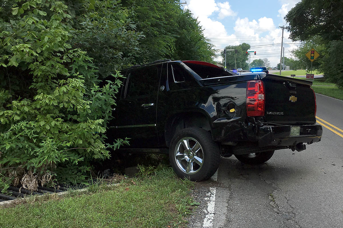 Chevrolet Avalanche that rammed off the road by the suspect in a Chevrolet Camaro.