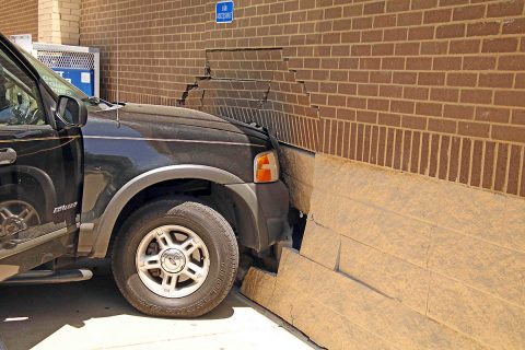 Woman crashes into the side of the Family Dollar store Monday afternoon. (Jim Knoll, Clarksville Police Department)