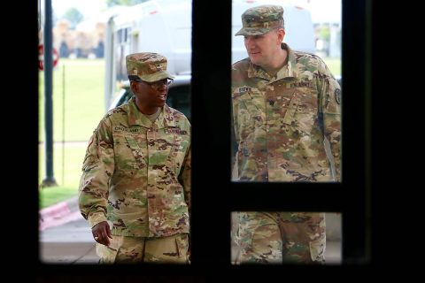 Brig. Gen. Telita Crosland, Regional Health Command-Atlantic commander, arrives at Blanchfield Army Community Hospital, Fort Campbell, Kentucky, June 27, escorted by Lt. Col. James Brown, Blanchfield's deputy commander for clinical services. Crosland assumed command of RHC-A, Army Medicine's largest regional health command, earlier this month and is circulating through the 14 medical treatment facilities and six direct reporting units in the region. (U.S. Army photo by Maria Yager)