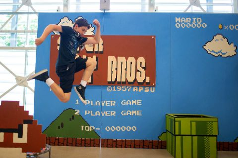 Life-sized set of Nintendo's 1985 classic Super Mario Bros allows students to run, jump and bash through the game.
