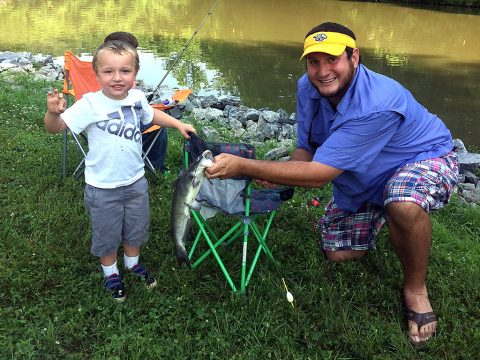 This boy and father celebrate catching a fish during the Cheatham Lake Annual Fishing Rodeo in Ashland City, Tennessee, June 16th, 2018. (Trey Church, USACE)