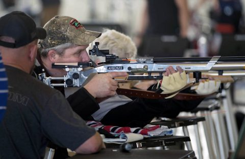 USSOCOM's Maj. Adam Ziegler practices air rifle during training for the 2018 DoD Warrior Games at MacDill Air Force Base in Florida on April 9, 2018. Participation in USSOCOM Warrior Care Program military adaptive sport events throughout the year enhances SOF athletes' mental and physical rehabilitation, aiding in their reintegration or transition. (Roger L. Wollenberg)