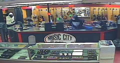 Suspects robbing Music City Pawn in Nashville, TN.