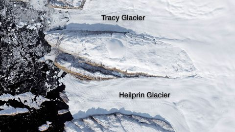 Tracy and Heilprin glaciers in northwest Greenland. The two glaciers flow into a fjord that appears black in this image. (NASA)