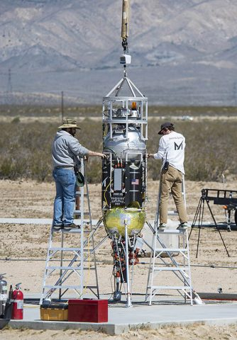 Masten Space Systems' technicians prepare their Xodiac rocket to flight test Honeybee Robotics pneumatic sampler collection system, PlanetVac, in Mojave Desert. (NASA Photo / Lauren Hughes)