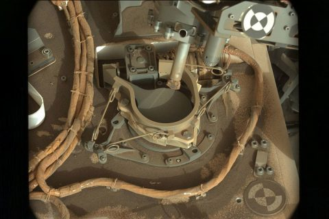 The drill bit of NASA's Curiosity Mars rover over one of the sample inlets on the rover's deck. The inlets lead to Curiosity's onboard laboratories. This image was taken on Sol 2068 by the rover's Mast Camera (Mastcam). (NASA/JPL-Caltech/MSSS)