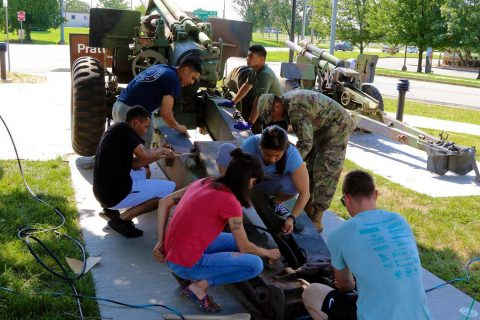 Soldiers of the 101st Airborne Division (Air Assault) clean a 155mm M114 howitzer, 29 June, at the Don F. Pratt Memorial Museum on Fort Campbell, Kentucky. (Pfc. Lynnwood Thomas, 40th Public Affairs Detachment)