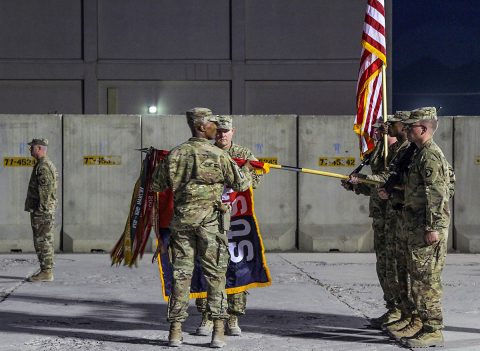 As the sun set, the brigade command team, consisting of Col. Stanley Sliwinski, commander of the 101st Airborne (Air Assault) Sustainment Brigade and CSM Anthony B. McAdoo, command sergeant major for 101st Sustainment Brigade, ceremoniously uncased the colors, marking the beginning of the brigade's fifth deployment to Afghanistan. (SSG Caitlyn Byrne, 101st SBDE PAO)