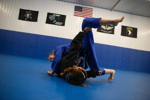 Brinna Lavelle spars with MiMi Bowen at Bowen Combative Arts Academy in Clarksville. Lavelle has been in judo since she was three.
