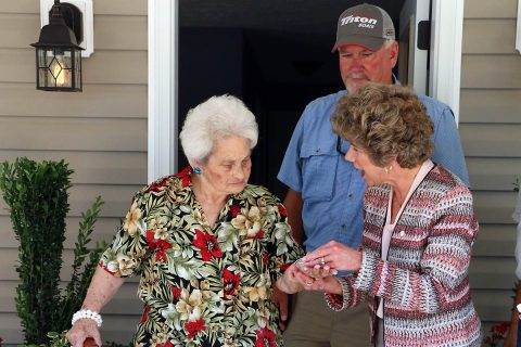 Clarksville Mayor Kim McMillan presents Mildred Johnson with a set of keys to her new home on June 29th. Johnson's home was originally a rehab project under the City's Housing Rehabilitation Program, but turned into a complete rebuild after extensive repairs were identified.