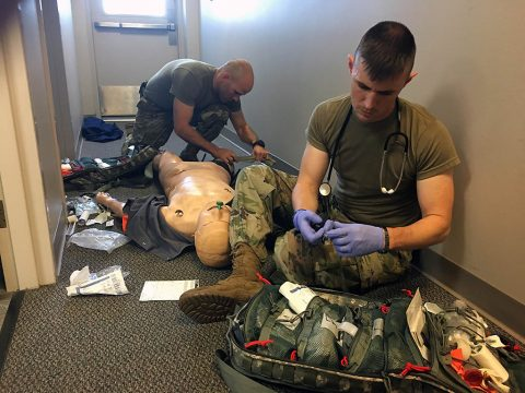 BACH's Soldiers, Maj. J. Tyler Garrett (rear) and Sgt. 1st Class Justin Cauthen (front), practice combat trauma assessment on a training  dummy, July 26th, in preparation for next week's 2018 Fort Campbell Best Medic Competition. Soldiers from RHC-A, which includes BACH, and Soldiers from the 101st Airborne Division (Air Assault) will compete together in the 2018 Fort Campbell Best Medic Competition July 30th to August 2nd.  (U.S. Army photo by Laura Boyd)