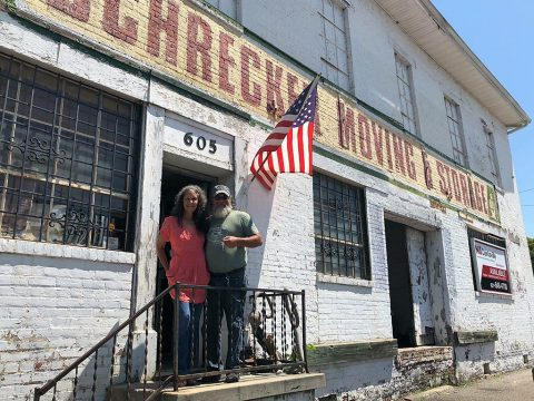 Manna Café's Kenny York and Victoria York in front of property that will become The Manna Village.