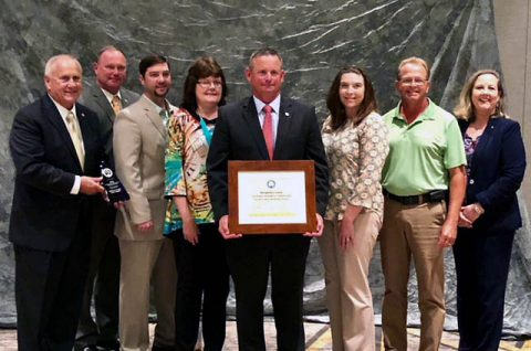 (L to R) Tennessee Deputy Governor Jim Henry, County Chief of Staff Jeff Truitt, County Engineer Nick Powell, County Administrative Assistant Emily Mathews, Montgomery County Mayor Jim Durrett, CMC Green Certification Manager Carlye Sommers, County Facilities Manager Kenneth Gentry and TDEC Commissioner Shari Meghreblian.