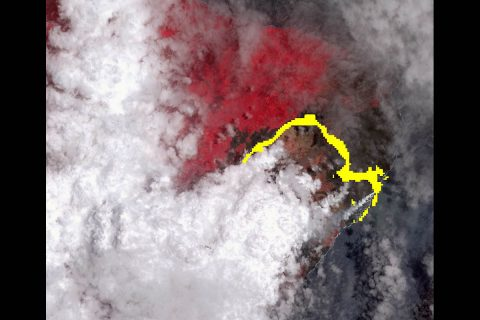 Lava from Hawaii's Kilauea Volcano flowing to the Pacific Ocean, imaged July 25th by NASA's Advanced Spaceborne Thermal Emission and Reflection (ASTER) instrument. Vegetation shown in red, clouds in white and lava in yellow. (NASA/METI/AIST/Japan Space Systems/U.S./Japan ASTER Science Team)