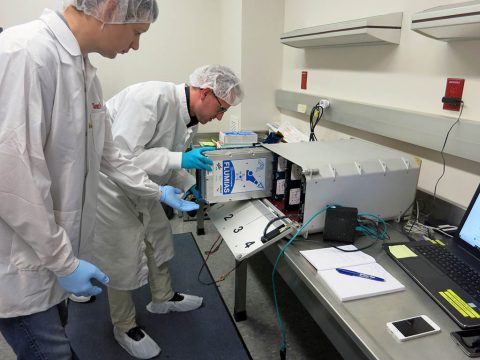 FLUMIAS team members install the 3D fluorescence microscope that will allow live-cell imaging in microgravity into Payload Card-8 of the TangoLab in preparation for launch aboard the SpaceX Dragon last month. (DLR)