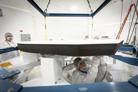 Parker Solar Probe's heat shield is made of two panels of superheated carbon-carbon composite sandwiching a lightweight 4.5-inch-thick carbon foam core. To reflect as much of the Sun's energy away from the spacecraft as possible, the Sun-facing side of the heat shield is also sprayed with a specially formulated white coating. (NASA/Johns Hopkins APL/Ed Whitman)