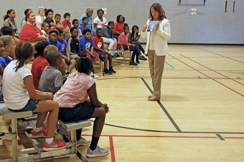Tennessee First Lady Crissy Haslam describes one of the books given away at the kick-off event for Read20 Book Patrol at the Kleeman Community Center July 9th, 2018. Read20 Book Patrol encourages children to read at least 20 minutes a day, while partnering with law enforcement to build positive relationships with officers in Tennessee communities.