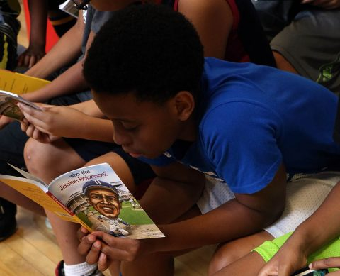 A young boy begins reading his new book during the kick-off event for Read20 Book Patrol at the Burt-Cobb Community Center July 9, 2018. Read20 Book Patrol is a program that is encouraging young children to read at least 20 minutes a day, while partnering with law enforcement to build positive relationships with officers in Tennessee communities.