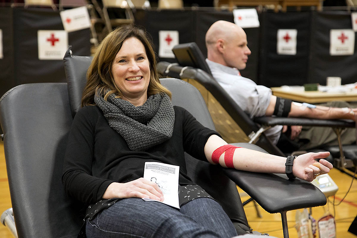 Heidi Reed relaxes in a donor chair following her blood donation. Reed's mother received blood during a surgery. (Amanda Romney/American Red Cross)