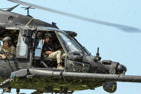 Secretary of the Army Dr. Mark T. Esper flies with 160th Special Operations Aviation Regiment, in a UH60 Blawkhawk, overtop Fort Campbell, Ky training areas on July 10th, 2018. The Secretary visited Fort Campbell on Tuesday to see the 101st Airborne Division's unique capabilities and the readiness of the division. (Sgt. Patrick Kirby, 40th Public Affairs Detachment)