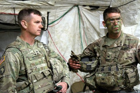 Col. John P. Cogbill, right, and Brig. Gen. K. Todd Royar, 101st Airborne Division deputy commanding general (Support), discuss 3rd BCT training inside the brigade tactical operations center in May. Hands-on training like this helps reinforce classroom instruction and encourages adaptive thinking, the author argues. (U.S. Army photo by Staff Sgt. Cody Harding, 3-101)