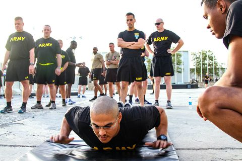 Senior leaders of the 101st Airborne Division (Air Assault) Resolute Support Sustainment Brigade participated in the Army Combat Fitness Test, Aug 14, 2018, on Bagram Airfield, Afghanistan. Service members stand in line waiting for their turn to participate in the hand release push up event. (1st Lt. Verniccia Ford, 101st Airborne Division (AA) Sustainment Brigade Public Affairs)