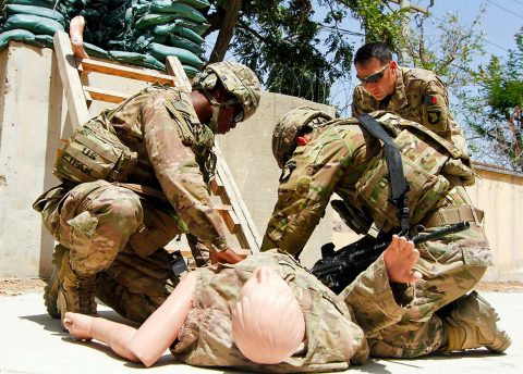 Sgt. First Class Frank Muramoto, 101st Airborne Division (Air Assault) Resolute Support Sustainment Brigade medical operations non-commissioned officer in charge, observes while PFC Keith Brown, and PFC Quesada-Hernandez, perform combat lifesaver techniques to a casualty dummy, on Bagram Airfield, Afghanistan, July 26.  (1st Lt. Verniccia Ford, 101st Airborne Division (AA) Sustainment Brigade Public Affairs)