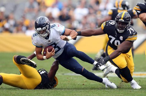 Pittsburgh Steelers linebacker Vince Williams (L) and defensive tackle Javon Hargrave (79) sack Tennessee Titans quarterback Marcus Mariota (8) during the second quarter at Heinz Field. (Charles LeClaire-USA TODAY Sports)